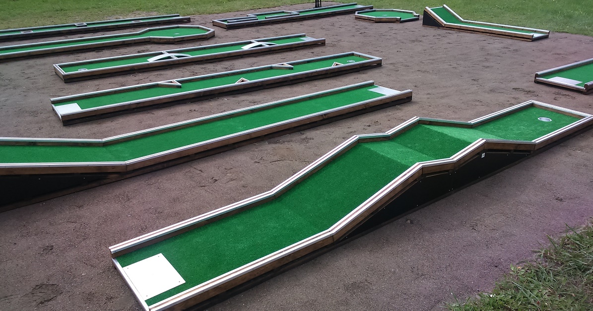 Small mini golf course with wooden frame Image