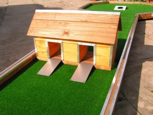 Mini golf obstacle wooden house with two entrances
